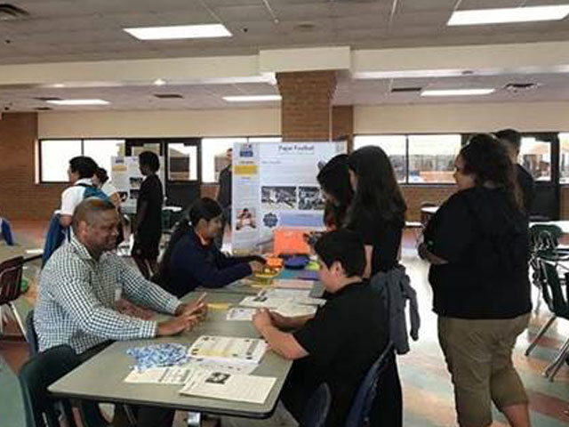 JQ'er Volunteers at STEM Night at Local School